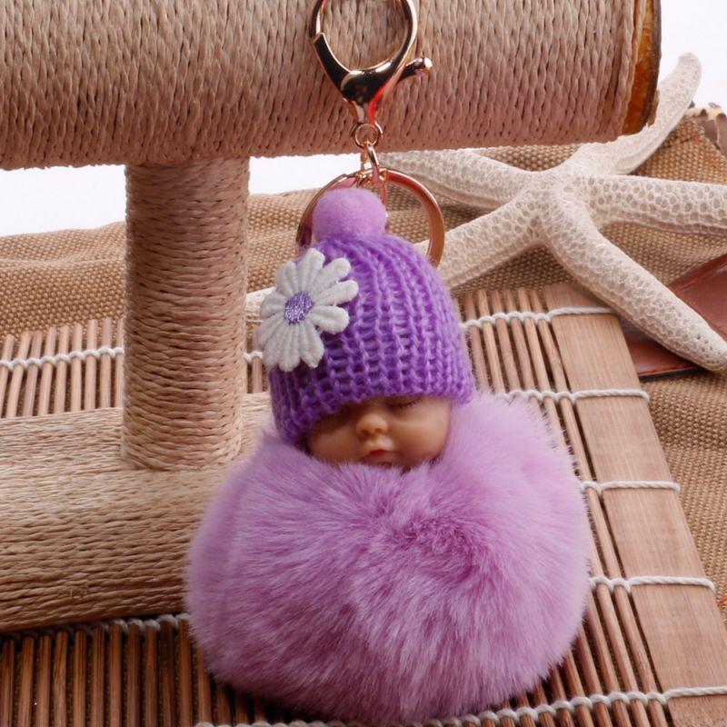 Spící miminko PomPom přívěsek na kabelku nebo klíče